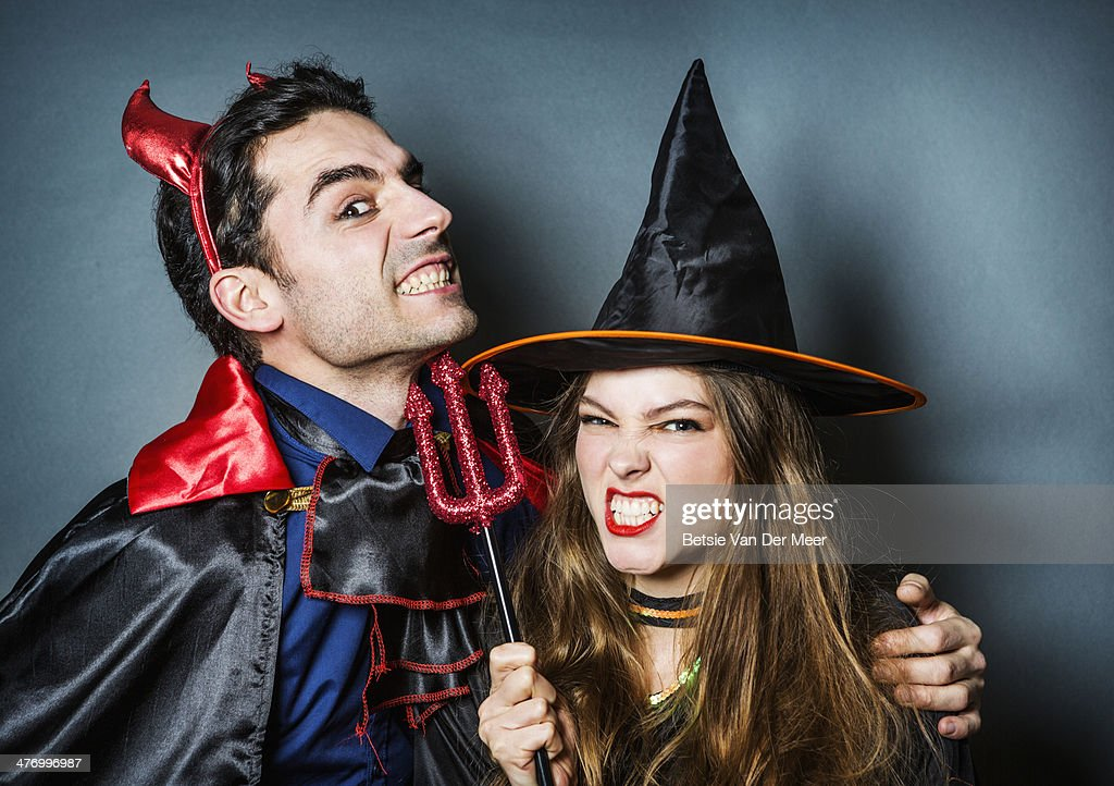 Halloween devil and witch pulling faces. : Stock Photo