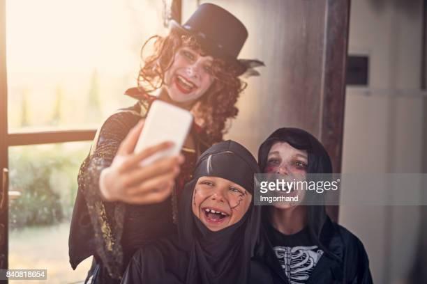 Halloween dressed up kinds making selfie