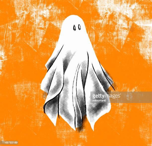 halloween ghost on a backgorund - aparición acontecimiento fotografías e imágenes de stock