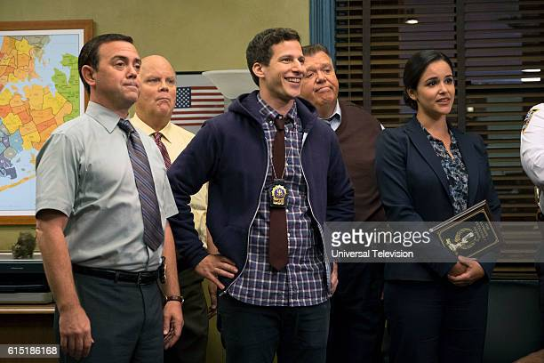 NINE 'Halloween IV' Episode 405 Pictured Joe Lo Truglio as Chales Boyle Dirk Blocker as Hitchcock Andy Samberg as Jake Peralta Joel McKinnon Miller...