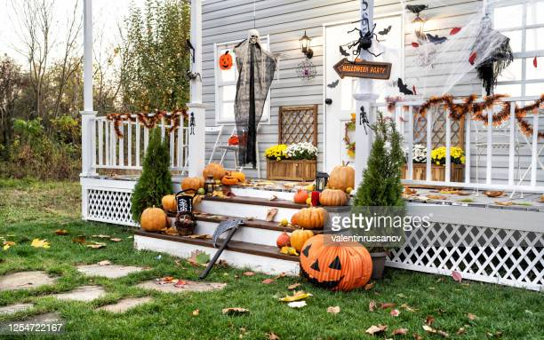 halloween jack-o-lantern pumpkins on a porch stairs - halloween decoration stock pictures, royalty-free photos & images