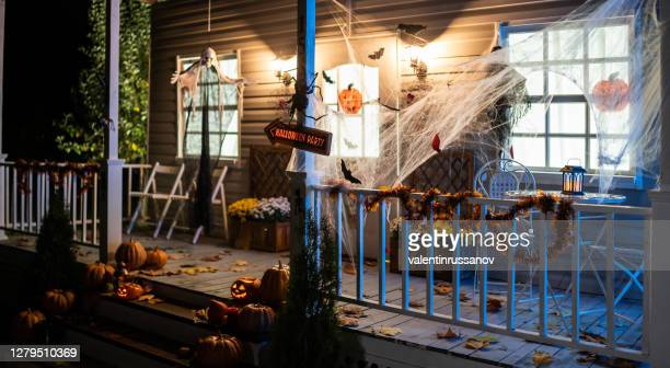 halloween jack-o-lantern pumpkins on a porch stairs - trick or treat stock pictures, royalty-free photos & images