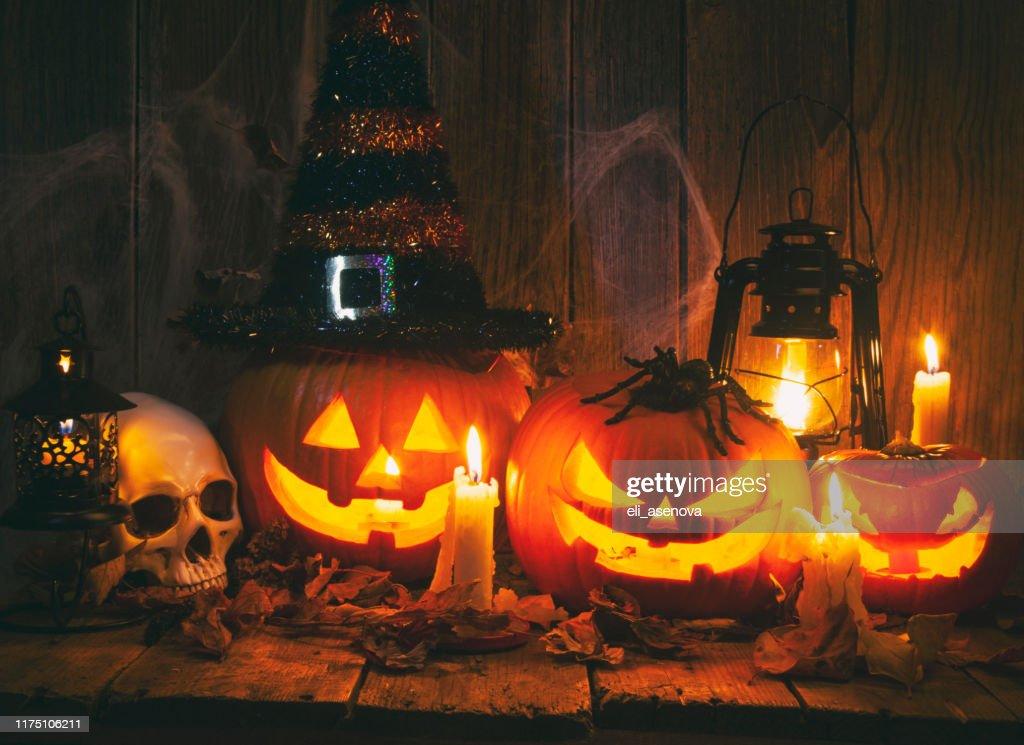 Halloween Jack-o-Lantern Pumpkins on rustic wooden background : Stock Photo
