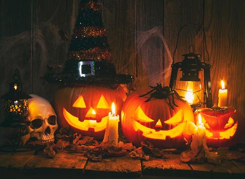 Halloween Jack-o-Lantern Pumpkins on rustic wooden background 1175106211