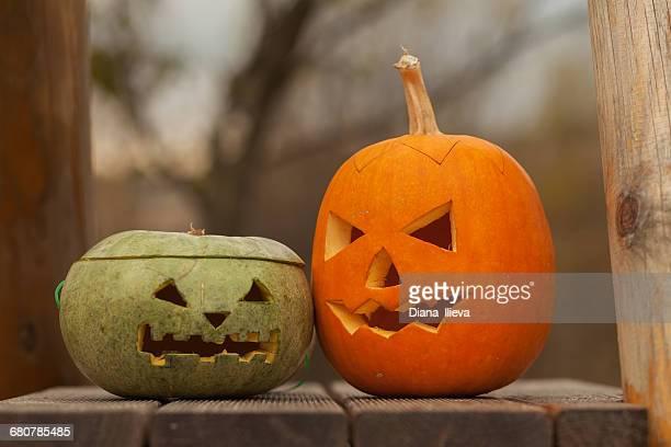 Halloween Jack-o-lantern pumpkins on wooden deck