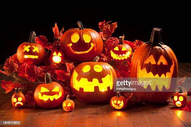 halloween jack-o-lantern pumpkins - halloween lantern stock photos and pictures