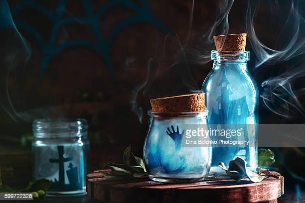 Halloween jars with smoke and zombies