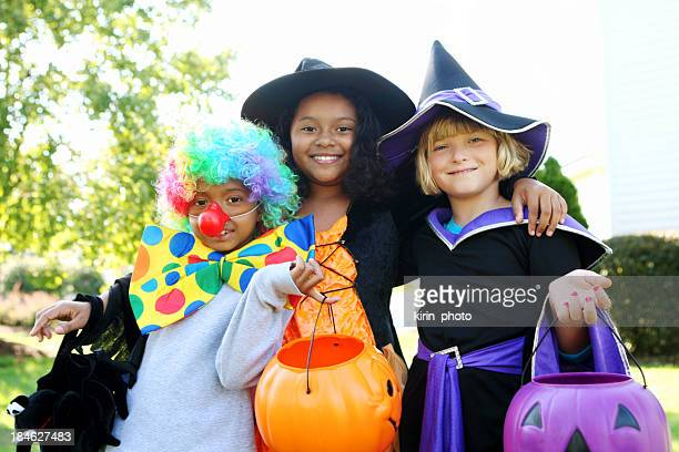 halloween kids in costumes smiling - halloween kids stock photos and pictures