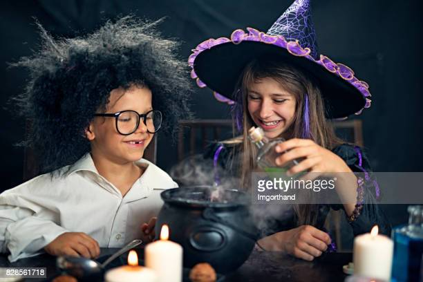 halloween kids playing with potions - potion stock photos and pictures