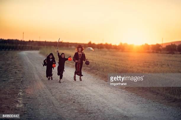 Halloween kids running home