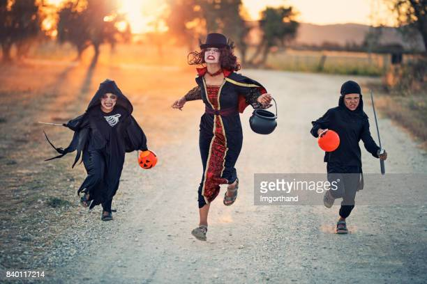 Halloween kids running on dirt road