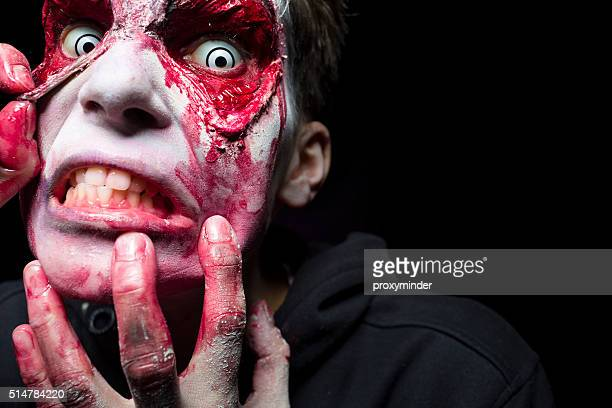 halloween man face - zombie makeup stock photos and pictures