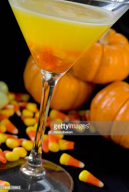 halloween martini with baby pumpkins and candy corn - candy corn stock photos and pictures
