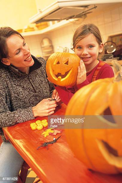 Halloween, mother and daughter in the kitchen