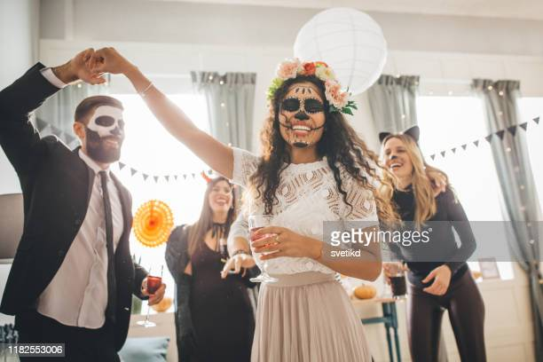 halloween multi ethnic party - mask disguise stock pictures, royalty-free photos & images