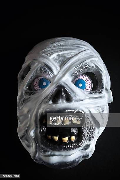 halloween mummy mask on black background - black mask disguise stock pictures, royalty-free photos & images