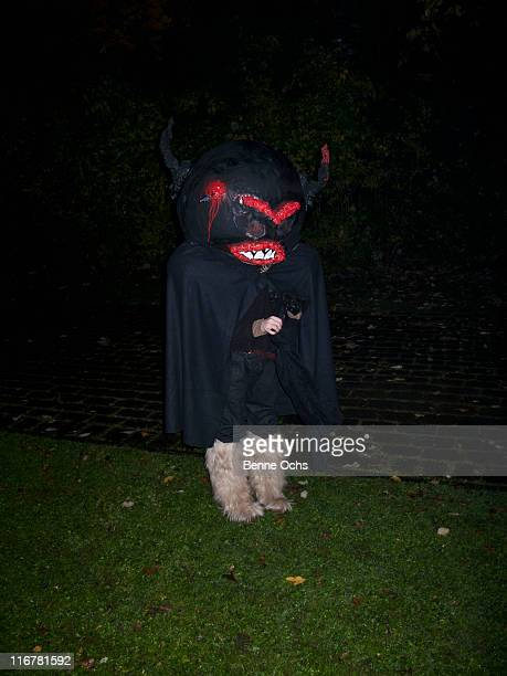 halloween outfit on the lawn. - shock tactics stock pictures, royalty-free photos & images