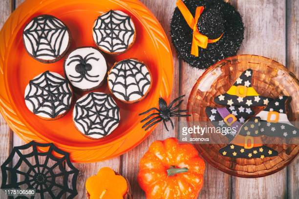 halloween party with homemade gingerbread cookies on white rustic wooden table - cat skeleton stock photos and pictures
