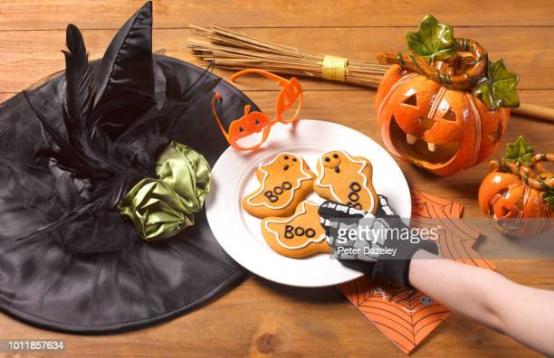 halloween party with witch's costume and cookies - naughty halloween stock photos and pictures