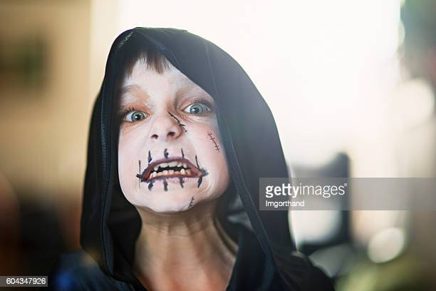 halloween portrait of a little boy dressed up as monster - imgorthand stock photos and pictures