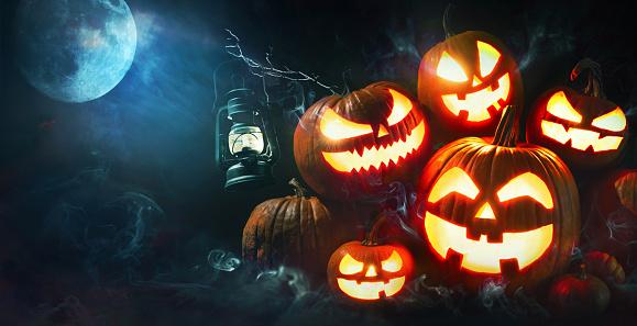 Halloween pumpkin head jack lantern with burning candles 1173573816
