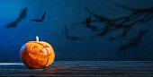 Halloween pumpkin on dark blue  background