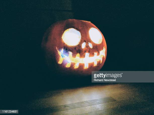 halloween pumpkin - scary pumpkin faces stock photos and pictures