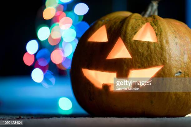 halloween pumpkin with blurred street lights - ugly pumpkins stock photos and pictures