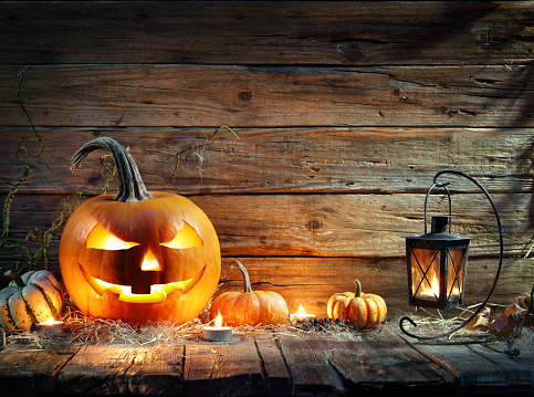 Halloween Pumpkins In Rustic Background With Lantern 1030495972