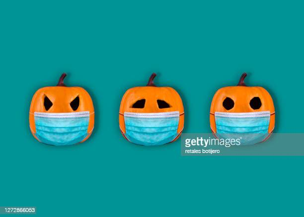 halloween pumpkins with surgical mask - halloween stock pictures, royalty-free photos & images