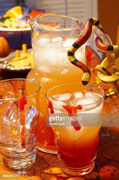 Halloween Punch in a Pitcher and Glasses; Snake on the Pitcher Handle