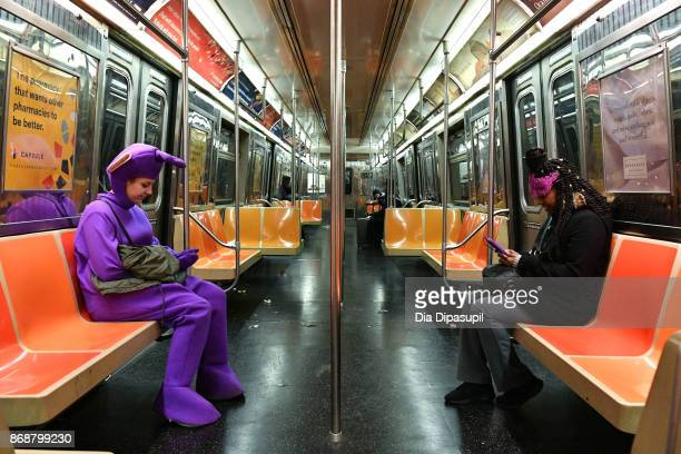 Halloween revelers are seen on the New York City subway on October 31 2017 in New York City