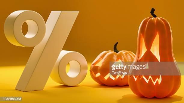 halloween sale. jack o lanterns on orange background - percentage sign stock pictures, royalty-free photos & images