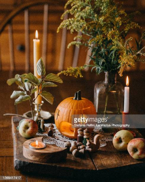 halloween set up on a wooden dining table - autumn decoration stock pictures, royalty-free photos & images