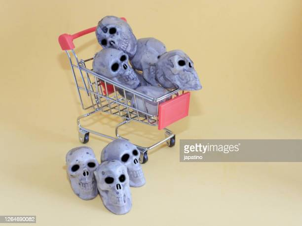 halloween shopping and shopping cart - commercial activity stock pictures, royalty-free photos & images