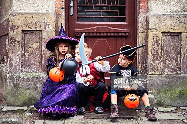 halloween sitting in fornt of old scary house - imgorthand stock photos and pictures