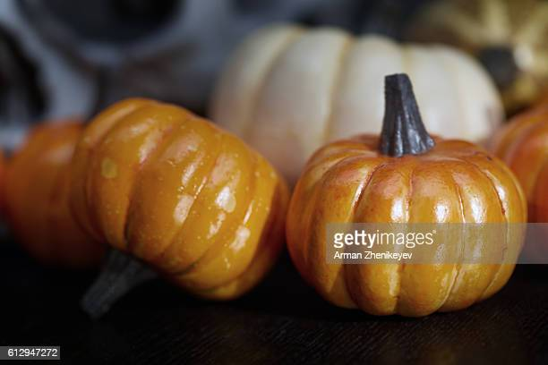 halloween skull and pumpkins - ugly pumpkins stock photos and pictures