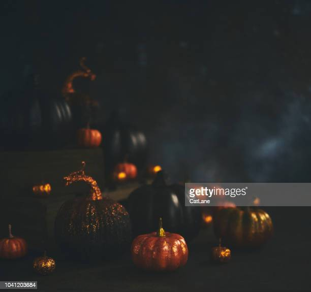 Halloween still life background with orange and black glittery pumpkins
