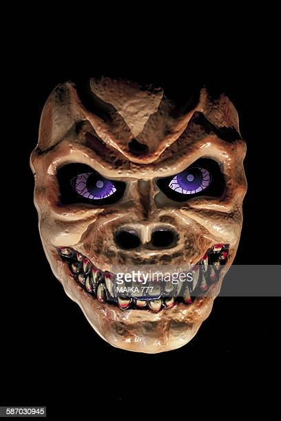 halloween terrifying mask on black background - black mask disguise stock pictures, royalty-free photos & images