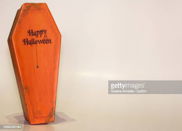 halloween text on coffin over beige background - coffin stock pictures, royalty-free photos & images