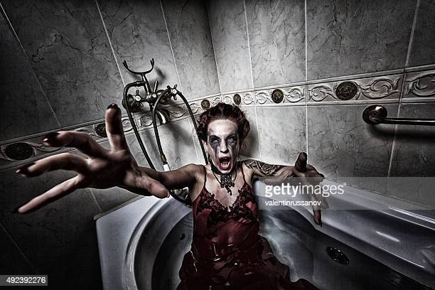 halloween theme.scary girl in bath. - zombie face stock photos and pictures