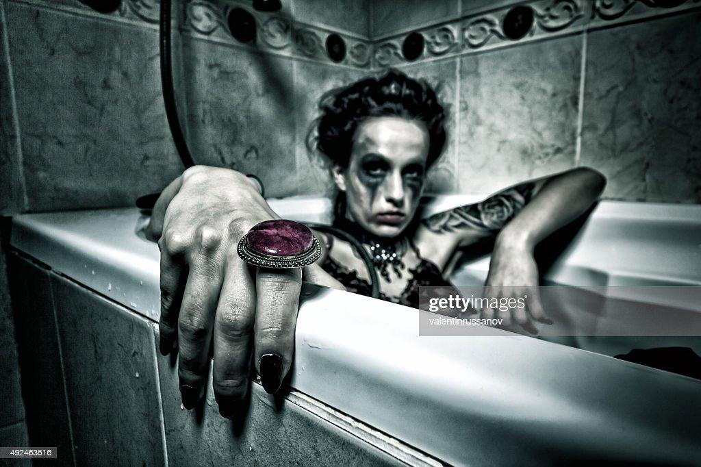 Halloween theme.Scary girl in bath. : Stock Photo