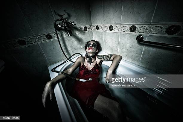 halloween theme.scary girl in bath. - zombie girl stock photos and pictures