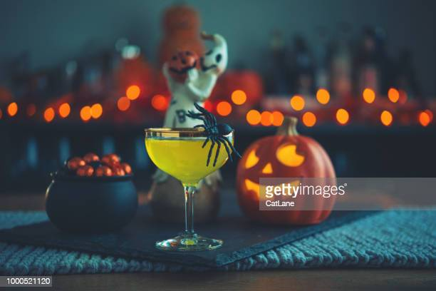 halloween time. vibrant colored drinks with cauldron of candy - happy halloween stock photos and pictures