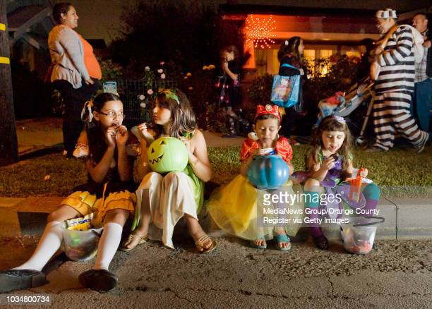 Halloween treatortreaters take a break on the curb on the the 500 block of E Palmyra Avenue in Orange to sample their candy INFORMATION...