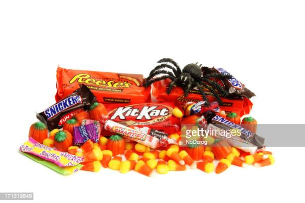 halloween trick or treat candies - pile of candy stock photos and pictures