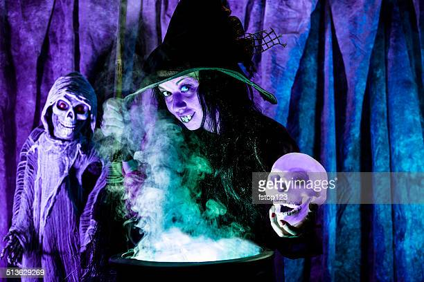 halloween:  witch cooking her brew for special guests. skull. - ugly black women stock photos and pictures