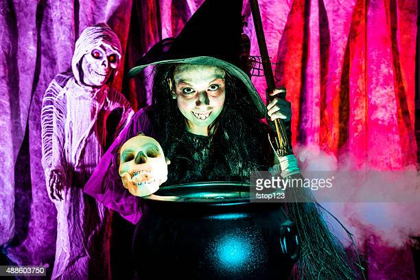halloween:  witch cooking her brew for special guests. skull. zombie. - ugly witches stock photos and pictures