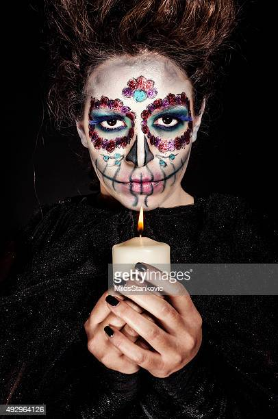 Halloween woman with candle
