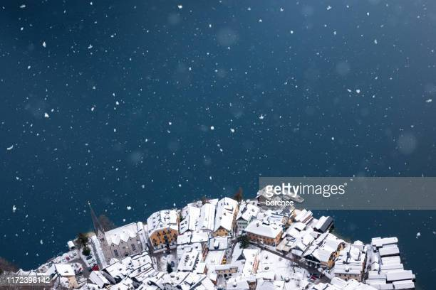 hallstatt covered with snow - hallstatt stock pictures, royalty-free photos & images
